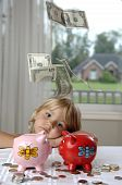 Little Girl, Cash And Piggy Banks