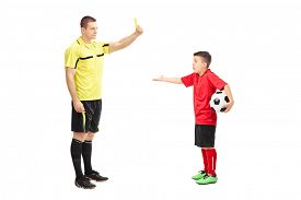 foto of referee  - Football referee showing yellow card to a junior soccer player isolated on white background - JPG