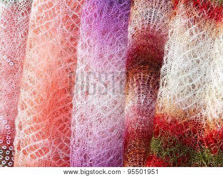 Colorful Orenburg Shawls Hanging For Sale.