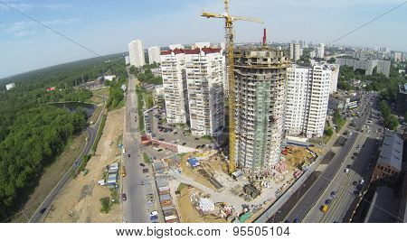 RUSSIA, MOSCOW - MAY 19, 2014: Builders work at construction site of residential complex Falcon Fort at sunny spring day. Aerial view