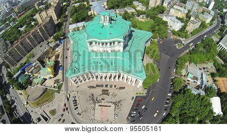 RUSSIA, MOSCOW - MAY 20, 2014: Cityscape with performance of military chorus near of Central Academic Theatre of Russian Army at sunny spring day. Aerial view
