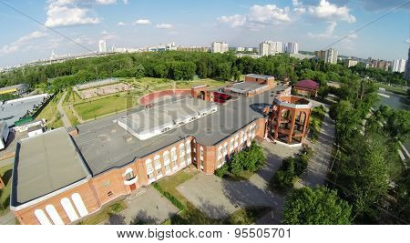 RUSSIA, MOSCOW - MAY 26, 2014: Cityscape with Palace of Children and Youth near Cherkizovsky pond at spring sunny day. Aerial view
