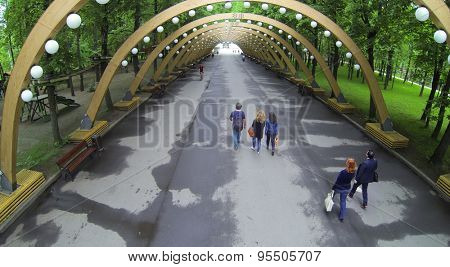 RUSSIA, MOSCOW - MAY 17, 2014: People walk in tunnel at spring day in park Sokolniki. Aerial view.
