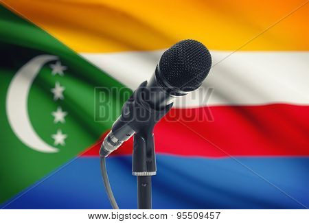 Microphone On Stand With National Flag On Background - Comoros
