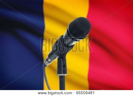 Microphone On Stand With National Flag On Background - Chad