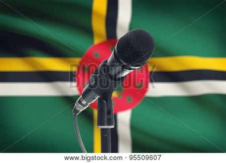 Microphone On Stand With National Flag On Background - Dominica