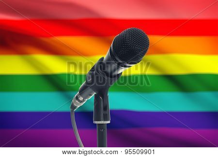 Microphone On Stand With National Flag On Background - Lgbt
