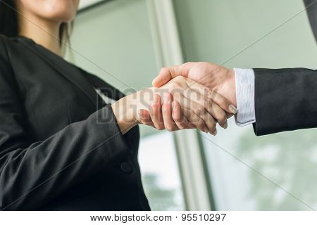 Asian business woman hold a man's hand, concept of teamwork.