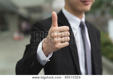 Asian business man give you a excellent gesture.