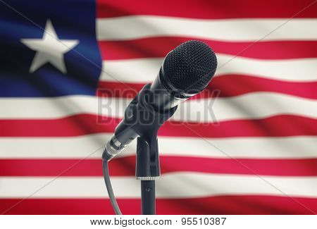 Microphone On Stand With National Flag On Background - Liberia