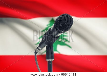 Microphone On Stand With National Flag On Background - Lebanon