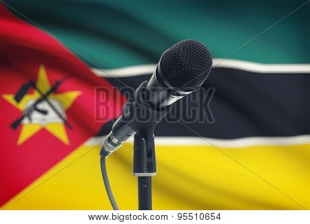 Microphone On Stand With National Flag On Background - Mozambique