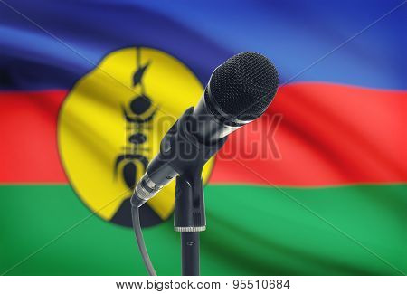 Microphone On Stand With National Flag On Background - New Caledonia