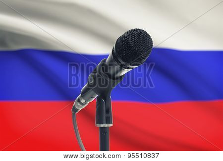 Microphone On Stand With National Flag On Background - Russia