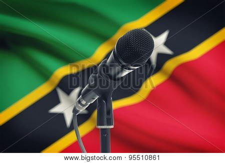 Microphone On Stand With National Flag On Background - Saint Kitts And Nevis