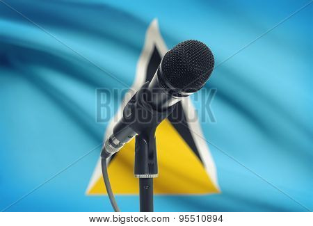 Microphone On Stand With National Flag On Background - Saint Lucia