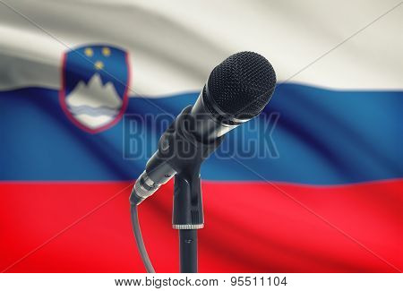 Microphone On Stand With National Flag On Background - Slovenia