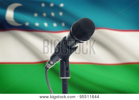 Microphone On Stand With National Flag On Background - Uzbekistan