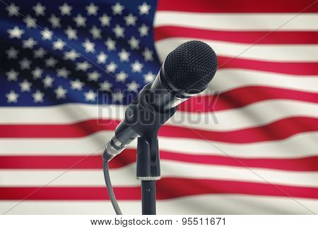 Microphone On Stand With National Flag On Background - United States