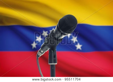 Microphone On Stand With National Flag On Background - Venezuela