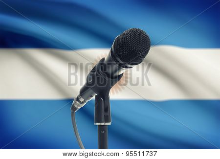 Microphone On Stand With National Flag On Background - Argentina