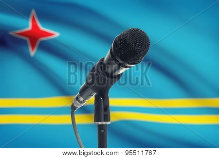Microphone On Stand With National Flag On Background - Aruba