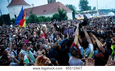 BONTIDA, ROMANIA - JUNE 27, 2015:Crowd surfing of Barry Ashworth from Dub Pistols at Electric Castle Festivall, one of the biggest music festivals in Romania