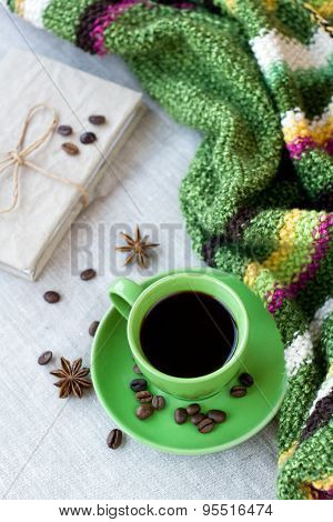 Green Cup Of Coffee With Coffee Beans And Anise Star