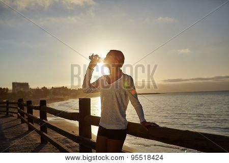 Young Runner Drinking From A Water Bottle