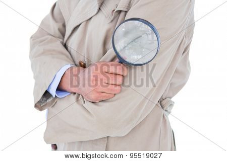 Spy looking through magnifier on white background