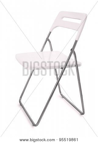White plastic folding chair isolated on white