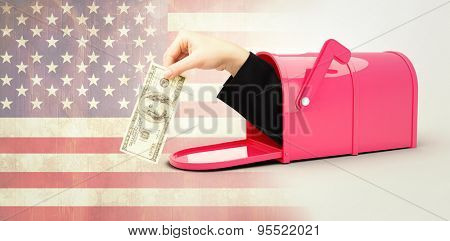 Businesswomans hand holding hundred dollar bill against usa flag in grunge effect