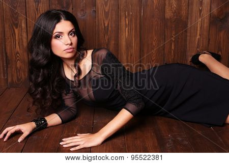 Sensual Woman With Dark Curly Hair In Elegant Black Dress With Accessories