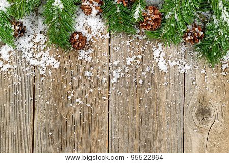 Christmas Border Decorations With Snow On Rustic Wooden Boards