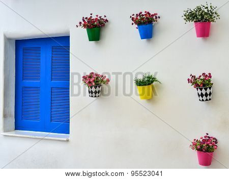 Blue Window And Colorful Fake Flower In The Zinc Vase