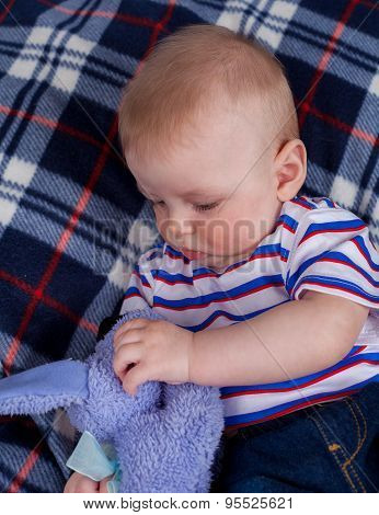 Little boy with plush toy