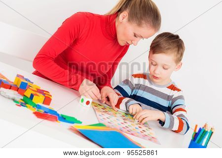 Mother and son playing  in  board game