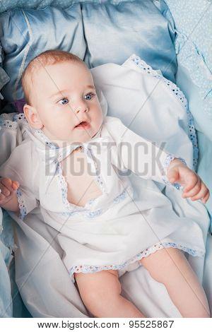 baby resting in cradle