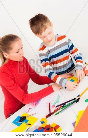 Son with mother making picture