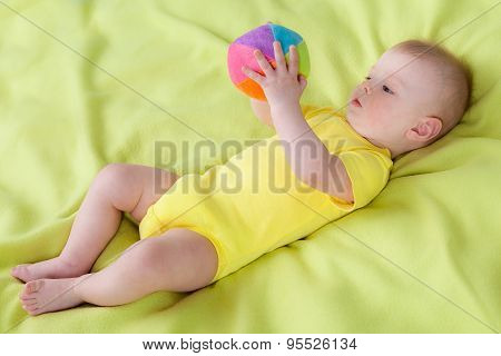 Little boy holding soft ball