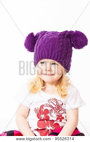 Smiling girl in knitted hat