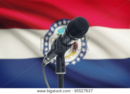 Microphone On Stand With Us State Flag On Background - Missouri