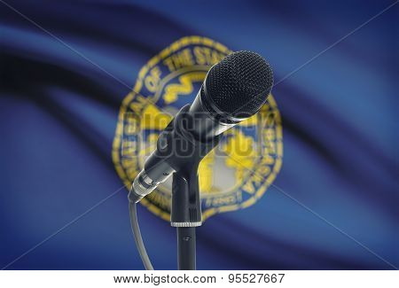 Microphone On Stand With Us State Flag On Background - Nebraska
