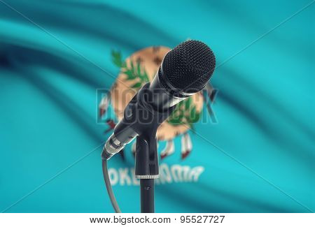 Microphone On Stand With Us State Flag On Background - Oklahoma