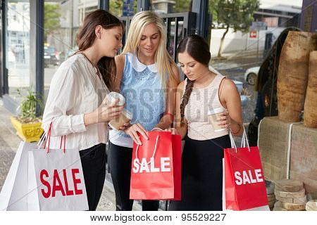 Teenager girls on shopping spree holding sale bags in city
