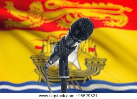 Microphone On Stand With Canadian Province Flag On Background - New Brunswick