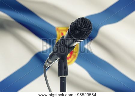 Microphone On Stand With Canadian Province Flag On Background - Nova Scotia