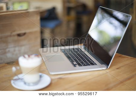 Laptop In Cafe