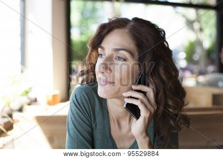 Woman Green Shirt On The Phone
