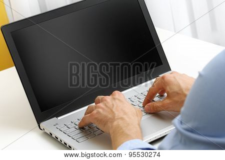 Businessman Typing On Laptop Computer